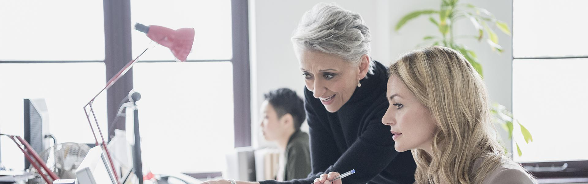Female colleagues collaborating in the workplace