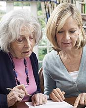 Woman offering aged care support