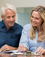 Couple examining pension options